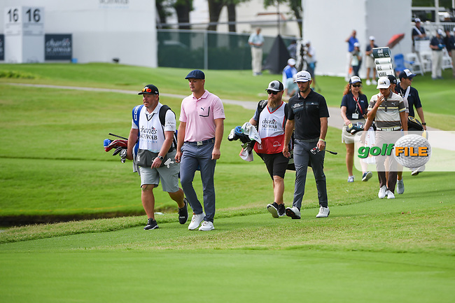 Bryson DeChambeau (USA), Max Homa (USA), and Rickie Fowler (USA) make their way down 16 during round 1 of the 2019 Charles Schwab Challenge, Colonial Country Club, Ft. Worth, Texas,  USA. 5/23/2019.<br /> Picture: Golffile | Ken Murray<br /> <br /> All photo usage must carry mandatory copyright credit (© Golffile | Ken Murray)