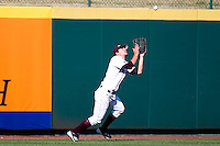 Dylan Becker (27) of the Missouri State Bears catches a fly ball to left field during a game against the Southern Illinois University- Edwardsville Cougars at Hammons Field on March 9, 2012 in Springfield, Missouri. (David Welker / Four Seam Images)
