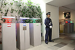 Security guard and exhibition about organic plants and sustainability at the Pasona building in central Tokyo; it is nine storeys high structure incorprating an urban farm where all of the food grown inside is harvested, prepared and served on-site in the cafeterias. The employees are encouraged to look after the vegetables and plants, which are on every floor and in social and public areas.<br />