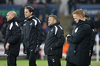(L-R) Adrian Tucker, goalkeeping coach for Swansea, Dr. Jez McCluskey, Club Doctor and Billy Reid, assistant manager for Swansea stand on the touch line during the Sky Bet Championship match between Swansea City and Sheffield United at the Liberty Stadium, Swansea, Wales, UK. Saturday 19 January 2019
