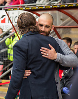 Leyton Orient Manager Omer Riza welcomes Wycombe Wanderers Manager Gareth Ainsworth ahead of the Sky Bet League 2 match between Leyton Orient and Wycombe Wanderers at the Matchroom Stadium, London, England on 1 April 2017. Photo by Andy Rowland.