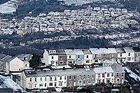 Pictured: Snow covered houses in St Thomas (TOP) and Mount Pleasant (FRONT) caused by the &quot;Beast from the East&quot; in Swansea, south Wales, UK. Wednesday 28 February 2018<br /> Re: Strong cold winds from the east have been affecting most parts of the UK with temperatures in some parts below zero.