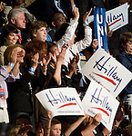 Former President Bill Clinton listens as Sen. Hillary Clinton, D-N.Y., speaks during the 2008 Democratic National Convention at the Pepsi Center in Denver, Colo., on Aug. 26, 2008.