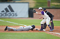 Luis Gimenez (14) of the Campbell Camels dives back towards first base as Daniel Millwee (22) of the High Point Panthers waits for a pick-off throw at Williard Stadium on March 16, 2019 in  Winston-Salem, North Carolina. The Camels defeated the Panthers 13-8. (Brian Westerholt/Four Seam Images)
