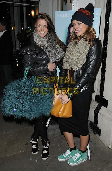 Brooke Vincent & Sacha Parkinson.attended the Pretty Little Thing s/s 2013 collection launch party, Sanctum Soho Hotel, London, England..January 16th, 2013.full length black leather jacket beanie hat skirt grey gray scarf bag purse blue fur teal yellow green trainers sneakers .CAP/CAN.©Can Nguyen/Capital Pictures.