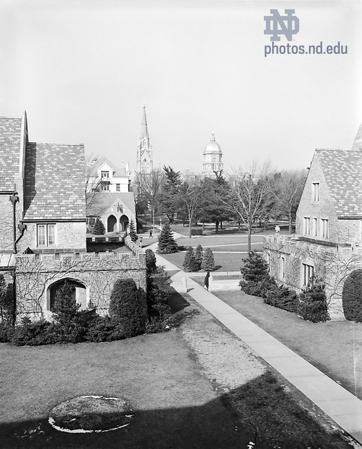 GPHR 45/0016:  View of Campus from Alumni and Dillon Halls Courtyard, includes Post Office (Knights of Columubs building), Walsh Hall, Basilica of the Sacred Heart Church, and Main Building, c1950s..Image from the University of Notre Dame Archives.