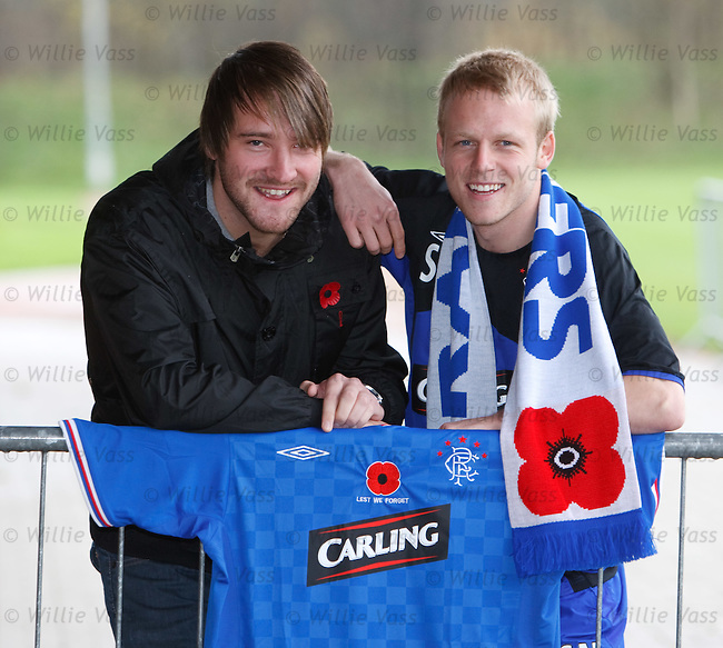 Steven Naismith displays the poppy strip to be worn by Rangers along with ex serviceman Stuart Proudfoot