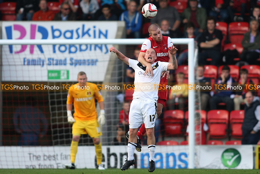 Ben Chorley of Leyton Orient heads from David Cotterill of Doncaster Rovers - Leyton Orient vs Doncaster Rovers - NPower League One Football at the Matchroom Stadium, Brisbane Road, London - 29/09/12 - MANDATORY CREDIT: George Phillipou/TGSPHOTO - Self billing applies where appropriate - 0845 094 6026 - contact@tgsphoto.co.uk - NO UNPAID USE.