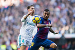 Jose Paulo Bezerra Maciel Junior, Paulinho (R), of FC Barcelona fights for the ball with Sergio Ramos of Real Madrid during the La Liga 2017-18 match between Real Madrid and FC Barcelona at Santiago Bernabeu Stadium on December 23 2017 in Madrid, Spain. Photo by Diego Gonzalez / Power Sport Images