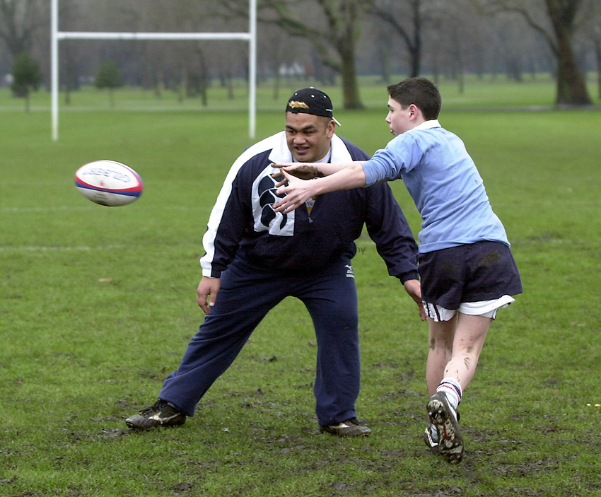 Photo:Ken Brown.22.1.2001 The RFU Youth Development Officers and Trevor Leota through his School of Hard Knocks attempt to recruit players to Rugby from inner-city London. Today they are at Bow Boys School London E3..Trevor helps out in a training exercise