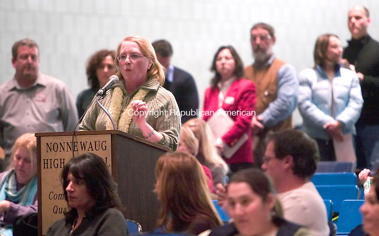 WOODBURY, CT- 08 JANUARY 2006-010807JS02-Woodbury resident Connie Conway asks questions to members of the Region 14 Board of Education during a public hearing Monday at Nonnewaug High School in Woodbury as other concerned citizens wait in line to speak. During the meeting, parents in Woodbury and Bethlehem got to question the administration about the planned reconfiguration of the elementary schools. <br /> Jim Shannon/Republican-American