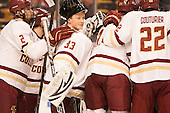 The Eagles including newest player Chuck Van Kula (BC - 33) gather around the net. - The Boston College Eagles defeated the Harvard University Crimson 3-2 in the opening round of the Beanpot on Monday, February 1, 2016, at TD Garden in Boston, Massachusetts.