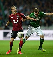 FUSSBALL   1. BUNDESLIGA   SAISON 2013/2014   11. SPIELTAG SV Werder Bremen - Hannover 96                         03.11.2013 Artur Sobiech (kli, Hannover) gegen Luca Caldirola (re, SV Werder Bremen)