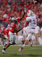 Ohio State Buckeyes linebacker Joshua Perry (37) gets after Wisconsin Badgers quarterback Joel Stave (2) during the third quarter of the game between Ohio State and Wisconsin at Ohio Stadium on Saturday, September 28, 2013. (Columbus Dispatch photo by Jonathan Quilter)