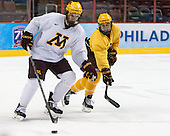 Jake Bischoff (MN - 28), Justin Kloos (MN - 25) - The University of Minnesota Golden Gophers practiced on Wednesday, April 9, 2014, at the Wells Fargo Center in Philadelphia, Pennsylvania during the 2014 Frozen Four.