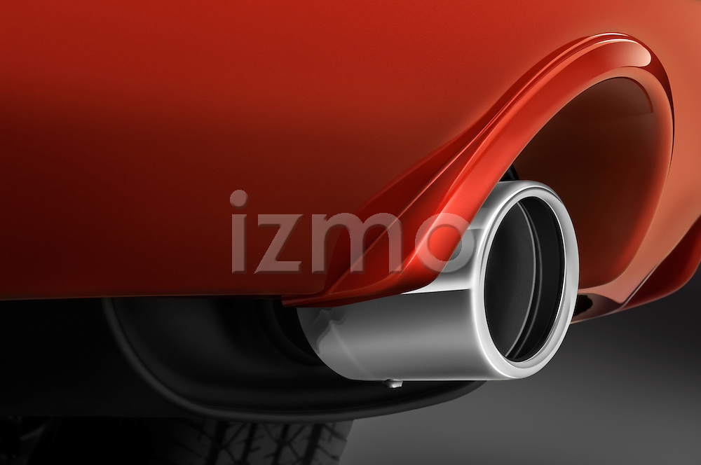 Closeup detail of a chome tip tail pipe on a 2009 Mitsubishi Eclipse GS Coupe