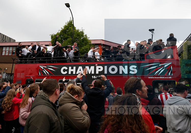 Fans follow the bus from Bramall Lane during the open top bus parade from Bramall Lane Stadium to Sheffield Town Hall, Sheffield. Picture date: May 2nd 2017. Pic credit should read: Simon Bellis/Sportimage