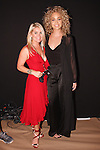 Model/actress Jasmine Sanders (right) and Jenny Shipley Buettner of Shibue Couture - the official undergarment, posing backstage before the Marchesa Spring 2017 collection fashion show in The Arc, Skylight at Moynihan Station on September 13, 2016 during New York Fashion Week Spring Summer 2016.