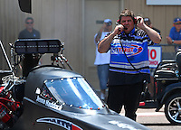 Jul. 20, 2014; Morrison, CO, USA; NHRA funny car driver Terry Haddock talks with wife top fuel driver Jenna Haddock over a 2-way radio during the Mile High Nationals at Bandimere Speedway. Mandatory Credit: Mark J. Rebilas-
