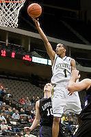 January 14, 2010:     Jacksonville guard Travis Cohn (1) goes up for a lay up during Atlantic Sun conference game action between the Jacksonville Dolphins and the Lipscomb Bisons at Veterans Memorial Arena in Jacksonville, Florida.  Jacksonville defeated Lipscomb 79-73.