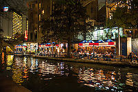 We took this of people dinning along the river walk in one of the many restautrants  in San Antonio after dark.  I would say the SA river walk is the most popular spot for toursit in the city.