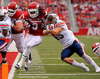 10/31/15<br /> Arkansas Democrat-Gazette/STEPHEN B. THORNTON<br /> Arkansas' Alex Collins runs inside the five as he is defended by Ut Martin's Caleb Counce, right,  in the  second quarter TD during their game Saturday in Fayetteville.