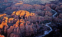Aerial, Bungle Bungle north Western Australia. Purnululu National Park in Western Australia comprises the Bungle Bungle Range; its distinctive beehive formation was shaped by 20 million years of erosion and uplift. The area has been used by Aboriginal people for thousands of years as a hunting ground during the wet season when plant and animal life is more abundant. As a result it is rich in Aboriginal artwork and burial sites, but few Europeans knew of its existence until the mid-1980s. The area was declared a national park in 1987, and a World Heritage Site in 2003 (for natural beauty) and again in 2005 (for cultural significance).