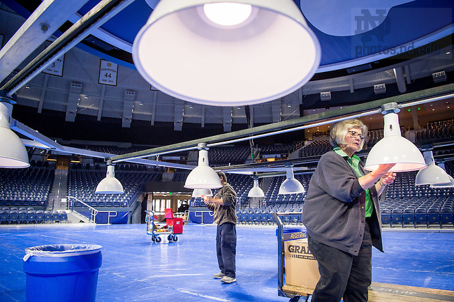 March 3, 2017; Joyce Center staff members install light bulbs in the lighting truss in preparation for the 2017 Bengal Bouts finals. (Photo by Matt Cashore/University of Notre Dame)