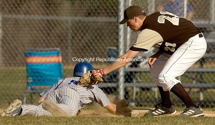 BURLINGTON, CT- 16 APRIL 2008 --041608JS08--Lewis Mills' Kyle Cruz (5) dives back to first bast in front of the tag by Thomaston's David Fredlund (21)during their game Wednesday at Lewis S. Mills High School in Burlington. <br /> Jim Shannon / Republican-American