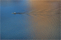 I was shooting from high above the waters of Lady Bird Lake when I noticed this lone kayaker skimming across the surface. As he passed between different colors in water (caused by reflections of the Austin skyline), I took several photos. I loved the transition between gold and blue.