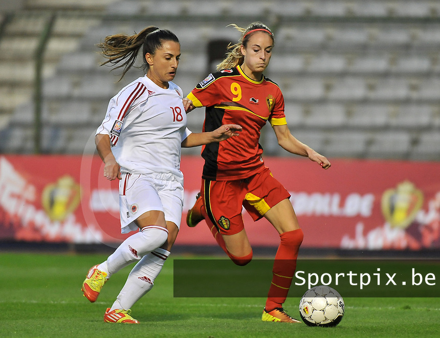 20130921 - BRUSSELS , BELGIUM : Belgian Tessa Wullaert (9) pictured with Albanian Denisa Proto (18) during the female soccer match between Belgium and Albania , on the first matchday in group 5 of the UEFA qualifying round to the FIFA Women World Cup in Canada 2015 at the Koning Boudewijn Stadion , Brussels . Saturday 21th September 2013. PHOTO DAVID CATRY