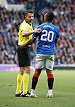 23.08.2018 Rangers v Ufa: Alfredo Morelos looking for some protection from ref Daniel Stefanski