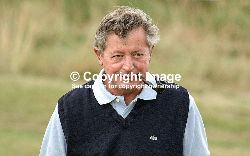 Maurice Bembridge, professional golfer, England, smoking pipe. Taken at British Seniors Open Championship at Royal County Down, Newcastle, N Ireland. Ref: 200107272899..Copyright Image from Victor Patterson, 54 Dorchester Park, Belfast, UK, BT9 6RJ..Tel: +44 28 9066 1296.Mob: +44 7802 353836.Voicemail +44 20 8816 7153.Skype: victorpattersonbelfast.Email: victorpatterson@mac.com.Email: victorpatterson@ireland.com (back-up)..IMPORTANT: If you wish to use this image or any other of my images please go to www.victorpatterson.com and click on the Terms & Conditions. Then contact me by email or phone with the reference number(s) of the image(s) concerned.