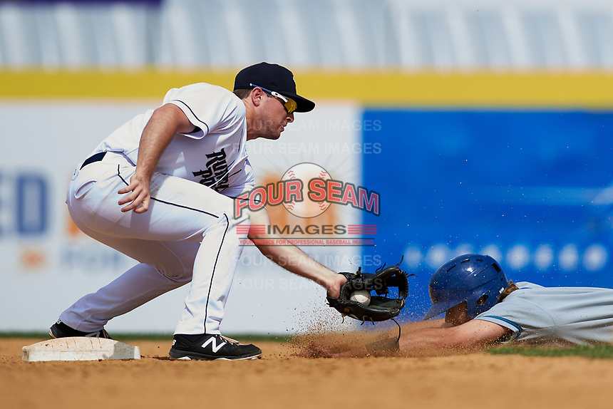 Binghamton Rumble Ponies second baseman Dale Burdick (1) puts a tag on a runner sliding into second during a game against the Hartford Yard Goats on July 9, 2017 at NYSEG Stadium in Binghamton, New York.  Hartford defeated Binghamton 7-3.  (Mike Janes/Four Seam Images)