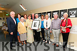 Kissane Family Photo Exhibition : Eamonn O'Murchu making a presentation of a framed photo to Eily Walsh of her parents at the opening of an exhibition off photos of the Kissane families at  Horseshoe Behan's Restaurant's new gallery on Sunday evening last. Front : Minister Jimmy Deenihan, who opened the wxhibition, Bridie Mai Beaton, Eily Walsh, Eamonn O'Murchu, Margaret & Jerry Behan & Nora O'Murchu. Back : Jane Harrison, Mary Kennelly, Johnny Walsh & Eilish Dore.