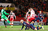 Tim Dieng of Bradford City has a header cleared off the line during the Sky Bet League 1 match between Doncaster Rovers and Bradford City at the Keepmoat Stadium, Doncaster, England on 19 March 2018. Photo by Thomas Gadd.