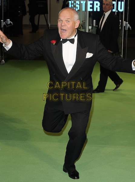 Mark Hadlow.The Royal Film Performance 2012 - 'The Hobbit: An Unexpected Journey' at the Odeon Cinema, Leicester Square, London, England..December 12th 2012.full length white bow tie black tuxedo mouth open hands arms funny.CAP/CAN.©Can Nguyen/Capital Pictures.