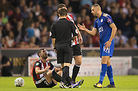 Islam Slimani of Leicester City talks to referee Tony Harrington after an off the ball incident could have seen him shown a second yellow during the Carabao Cup match between Sheffield United and Leicester City at Bramall Lane, Sheffield, England on 22 August 2017. Photo by James Williamson / PRiME Media Images.