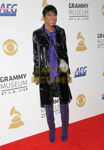 NATALIE COLE <br /> attends The GRAMMY Nominations Concert Live!! held at Nokia Theatre L.A. Live in Los Angeles, California on December 3rd 2008.<br /> full length black coat patent bag knee high boots dangly earrings purple <br /> CAP/DVS<br /> &copy;Debbie VanStory/Capital Pictures