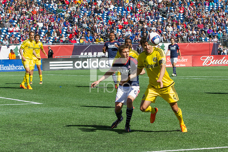Foxborough, Massachusetts - April 11, 2015:  The New England Revolution (blue and red) and Columbus (black and gold) drew 0-0 in a Major League Soccer (MLS) match at Gillette Stadium.