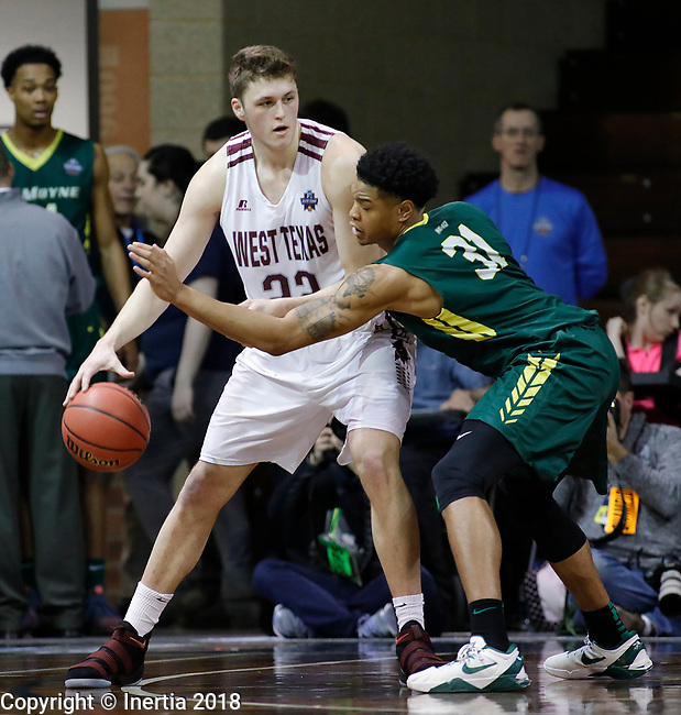 SIOUX FALLS, SD: MARCH 20:  Ryan Quaid #22 of West Texas A&M shields the ball from Daniel Kaigler #31 of Le Moyne during their game at the 2018 Division II Men's Elite 8 Basketball Championship at the Sanford Pentagon in Sioux Falls, S.D. (Photo by Dick Carlson/Inertia)
