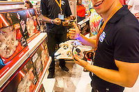 "A sales associate displays a Star Wars drone in the Toys R Us store in Times Square in New York on so-called ""Force Friday"", September 4, 2015. ""Force Friday"" is the name given by the Walt Disney Co. on the release of the Star Wars merchandise, three months prior to the release of the film. Disney acquired the Star Wars franchise in 2012 when it bought Lucasfilm for $4.1 billion. (© Richard B. Levine)"