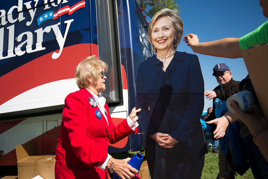 Supporters pose with a cardboard cut out of Hillary Clinton at the Tom Harkin Steak Fry in Indianola,  Iowa