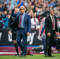 West Ham Utd Manager Manuel Pellegrini punches the air at full time during the Premier League match between West Ham United and Manchester United at the Olympic Park, London, England on 22 September 2019. Photo by Andy Rowland / PRiME Media Images.