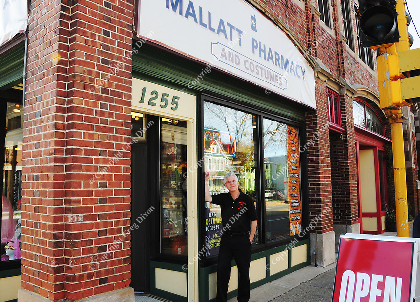 Mike Flint, owner of Mallatt Pharmacy and Costume,  poses in front of his Mallatt's Williamson Street location on Wednesday in Madison