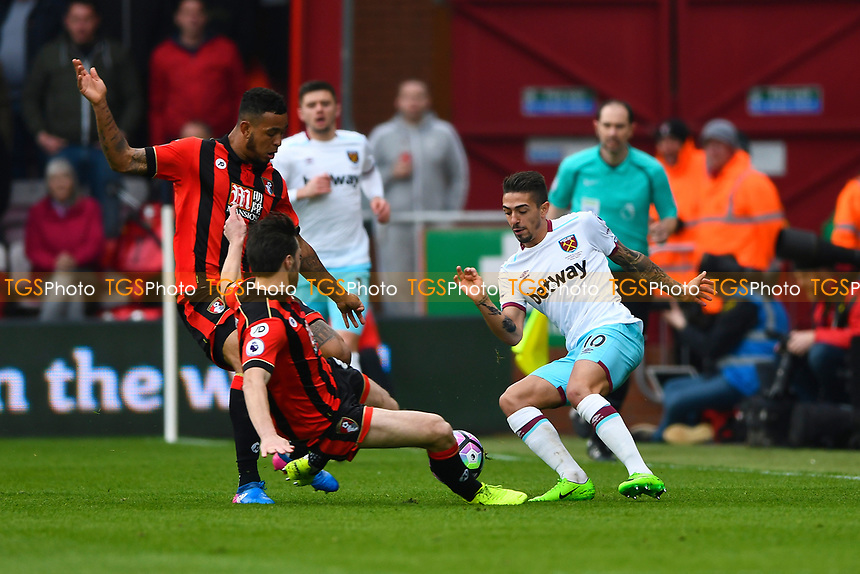 Harry Arter of AFC Bournemouth lunges in at Manuel Lanzini of West Ham United during AFC Bournemouth vs West Ham United, Premier League Football at the Vitality Stadium on 11th March 2017