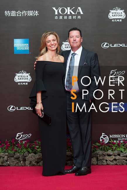 Rich Beem and his wife on the Red Carpet event at the World Celebrity Pro-Am 2016 Mission Hills China Golf Tournament on 20 October 2016, in Haikou, China. Photo by Weixiang Lim / Power Sport Images