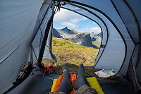 Looking out door of tent across mountain landscape, Moskenesøy, Lofoten Islands, Norway