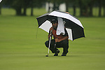 Shiv Kapur (IND) shelters from the rain on the 1st green during Day 1 of the BMW International Open at Golf Club Munchen Eichenried, Germany, 23rd June 2011 (Photo Eoin Clarke/www.golffile.ie)