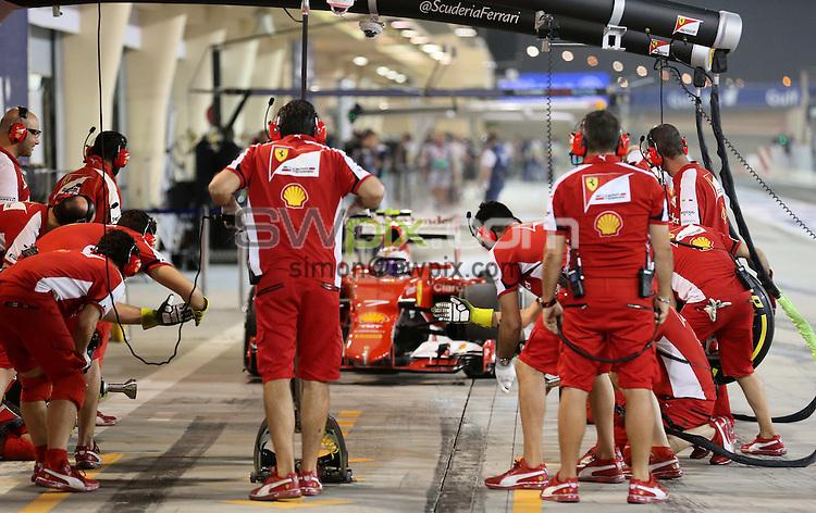 PICTURE BY MARK GREEN/SWPIX.COM - Formula 1, Bahrain International Circuit, 17-19th April 2015 <br /> Ferrari crew prepare for Finnish Driver Kimi Raikkonen